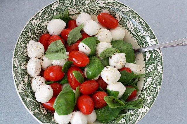 caprese salad in a green bowl
