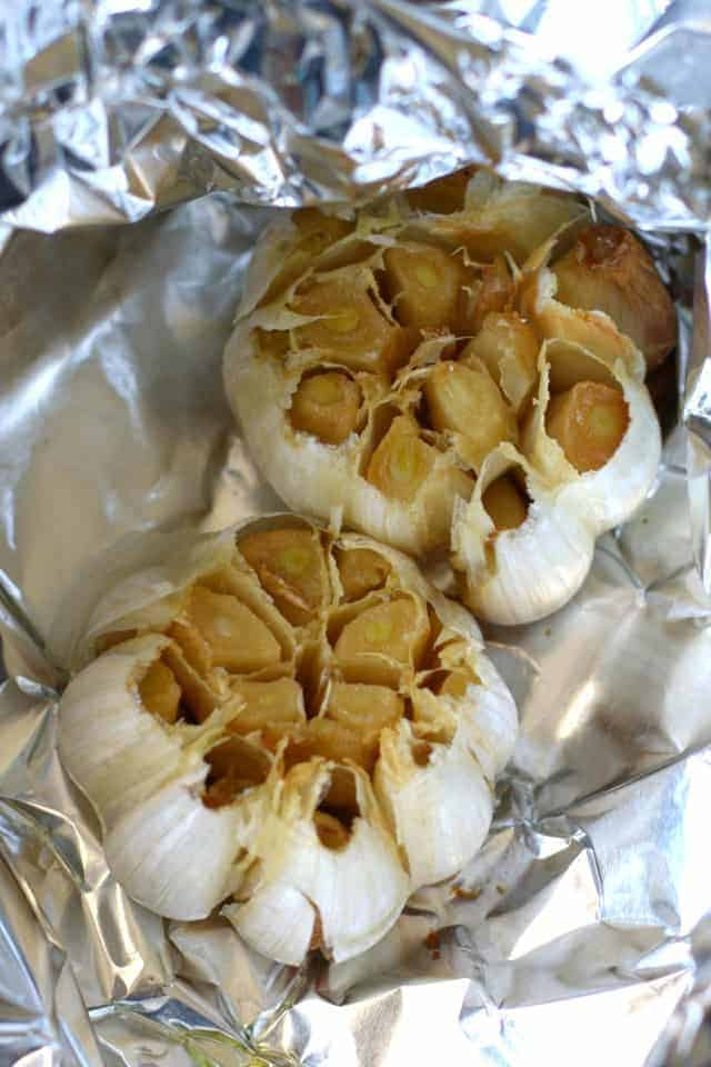 heads of roasted garlic on foil