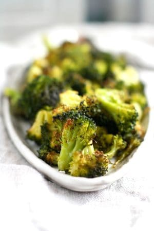 garlic roasted broccoli on a white platter