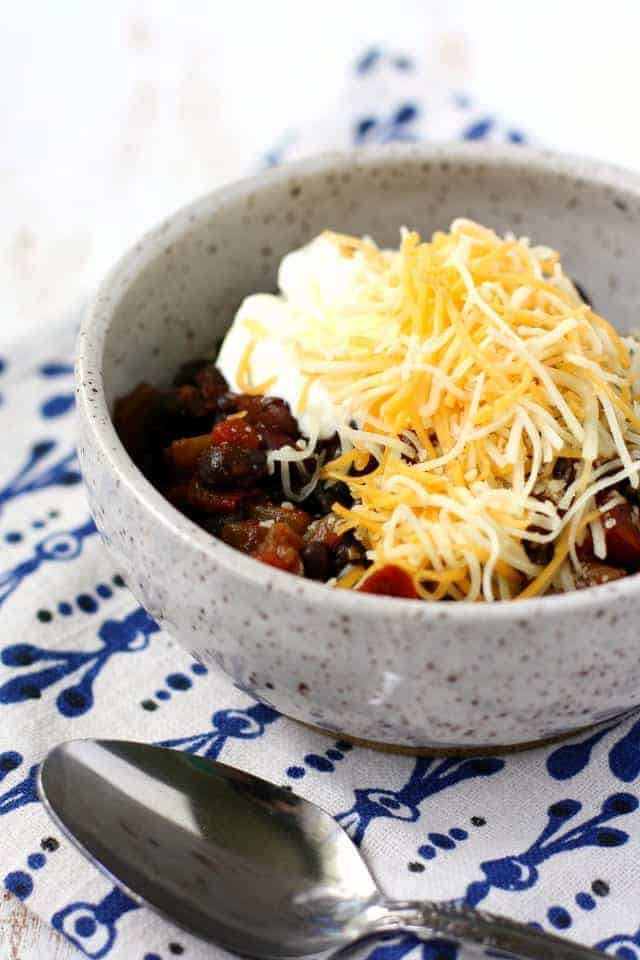 beans and rice in a bowl with sour cream