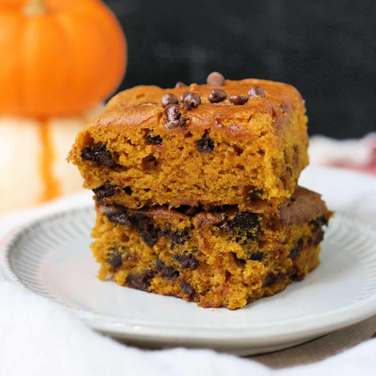 gluten free pumpkin bars on a white plate with chocolate chips