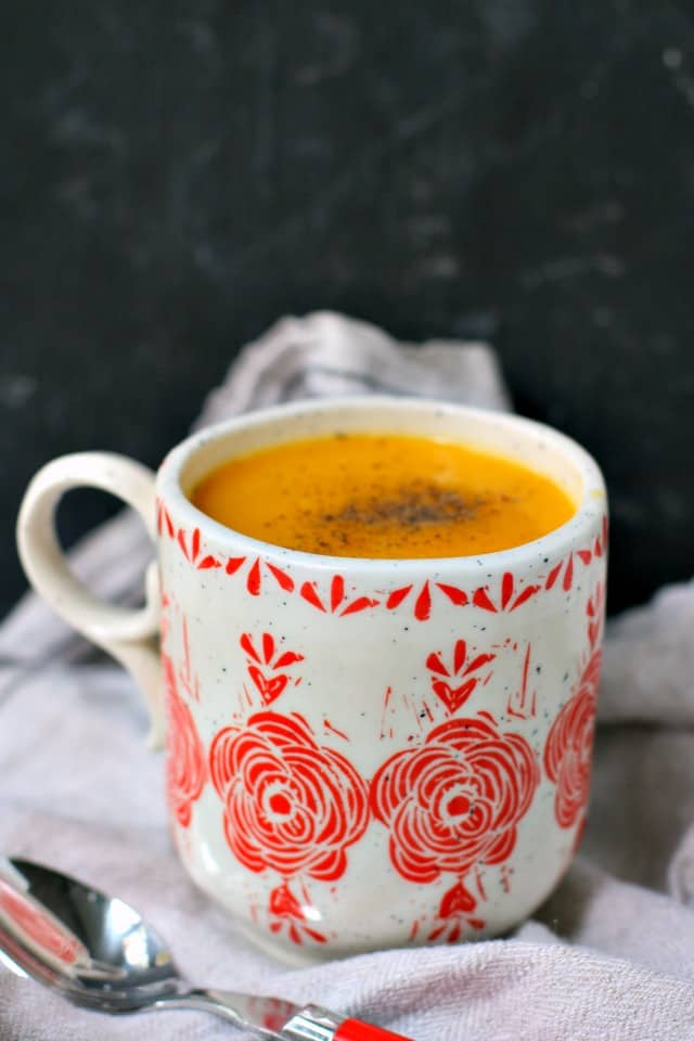dairy free butternut squash soup in a red and white mug