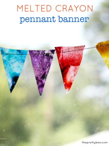 A colorful project to hang in the window - a melted crayon and waxed paper pennant banner.