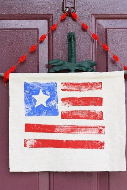 stamped flag hanging for front door