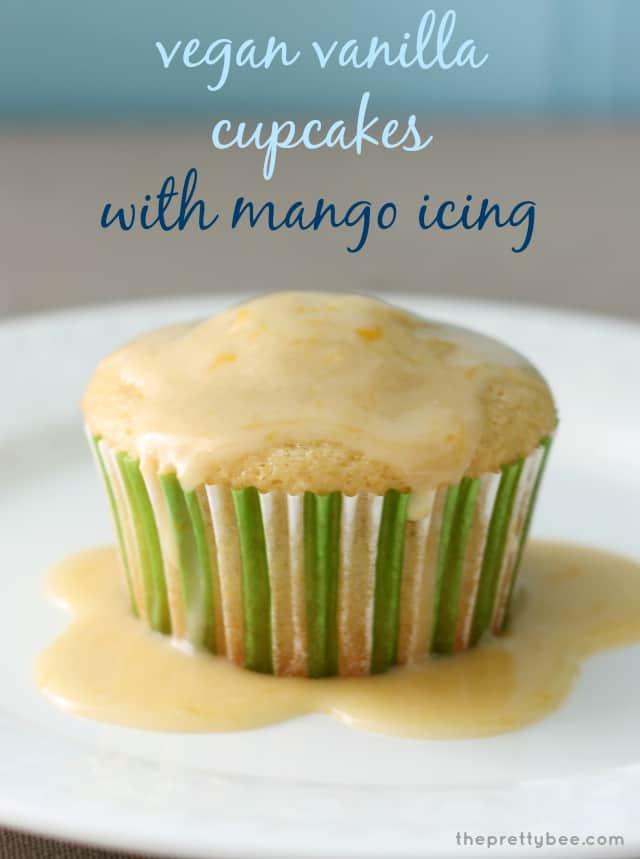 Simple vanilla cupcakes with a fruity mango glaze on top. #vegan