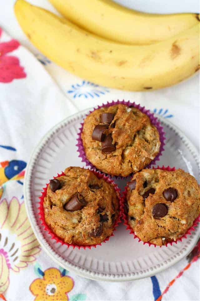 gluten free banana chocolate chip muffins on a white plate