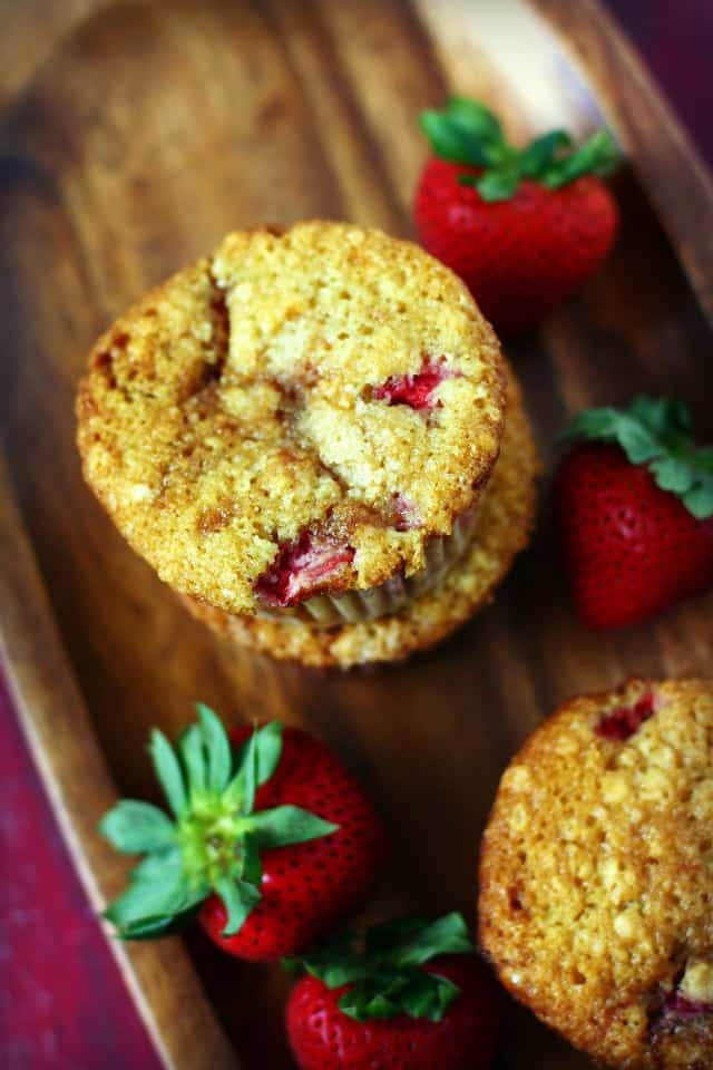 strawberry lemon muffins on a tray with berries