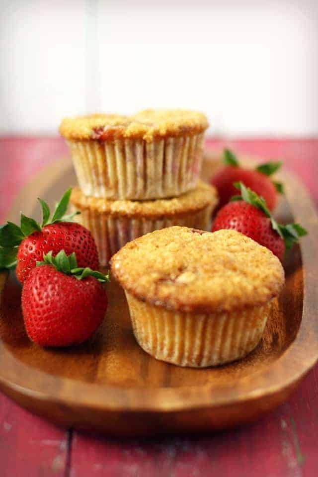 vegan strawberry lemon muffins on a wood tray
