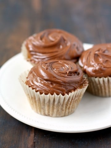 An easy recipe for vegan yellow cupcakes with chocolate frosting.