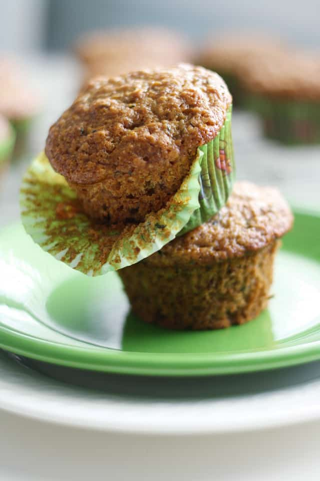 two vegan zucchini muffins stacked