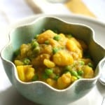 Potatoes and peas in a creamy, spicy, dairy free sauce. Easy vegan and gluten free comfort food.