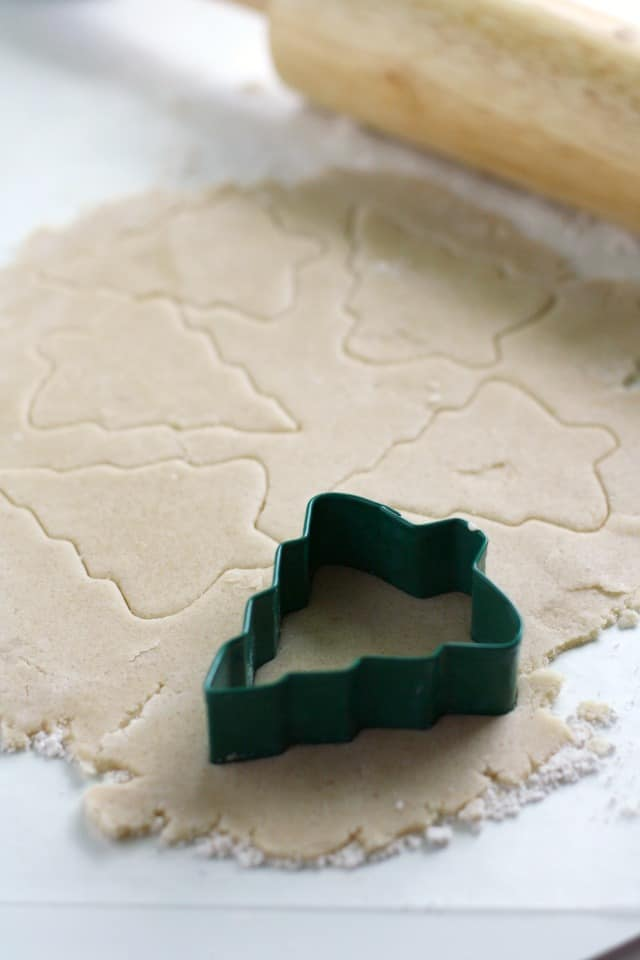 cutting out vegan sugar cookies