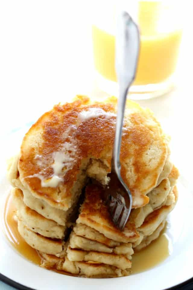 fluffy vegan pancakes with maple syrup