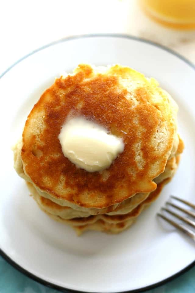 light fluffy vegan pancakes on white plate with fork