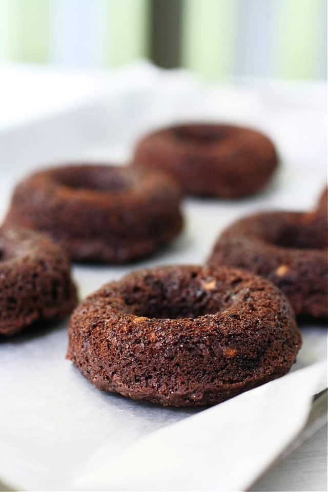 vegan chocolate donuts on a baking sheet