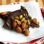 This decadent dark chocolate bark with almonds and pistachios requires just four ingredients and a minute in the microwave! An easy dessert recipe.