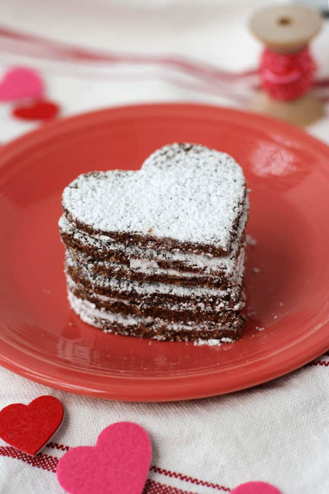 stack of gluten free heart cookies on a plate