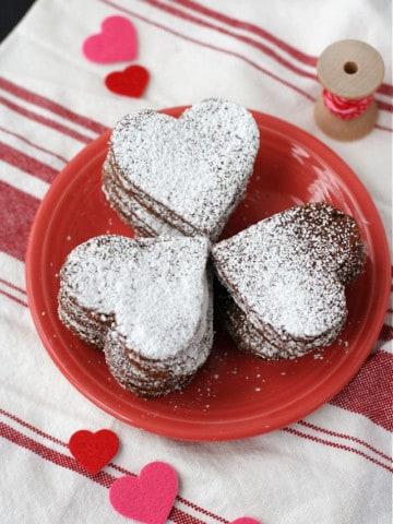 vegan gluten free chocolate cookies on a pink plate