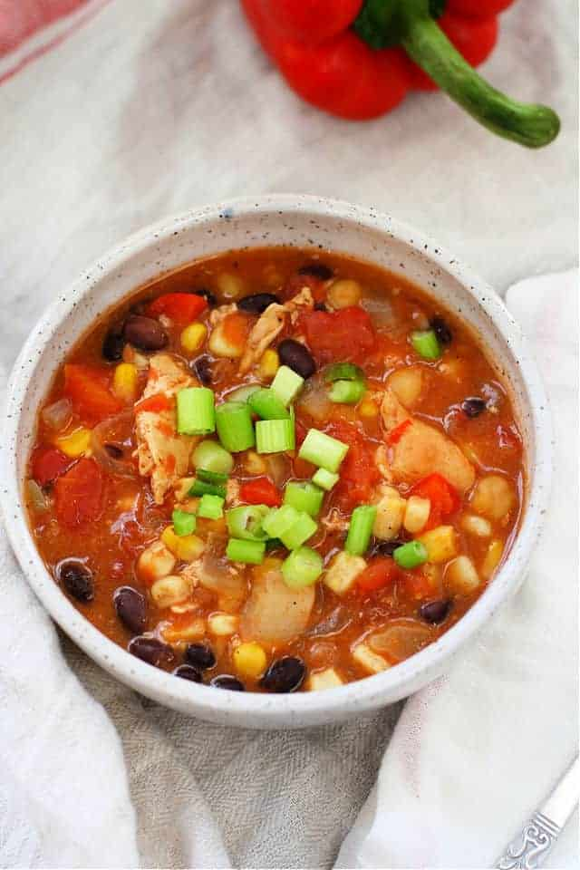 chicken and bean chili in a white bowl