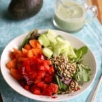 A veggie filled salad topped with creamy avocado garlic dill dressing. Vegan.