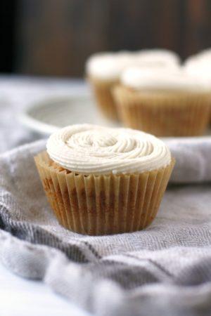 vegan vanilla cupcakes sitting on a tea towel