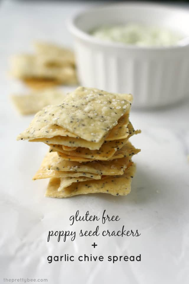 stack of gluten free crackers and dip in a white ramekin