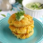 Delicious fried corn cakes with cilantro avocado cream.