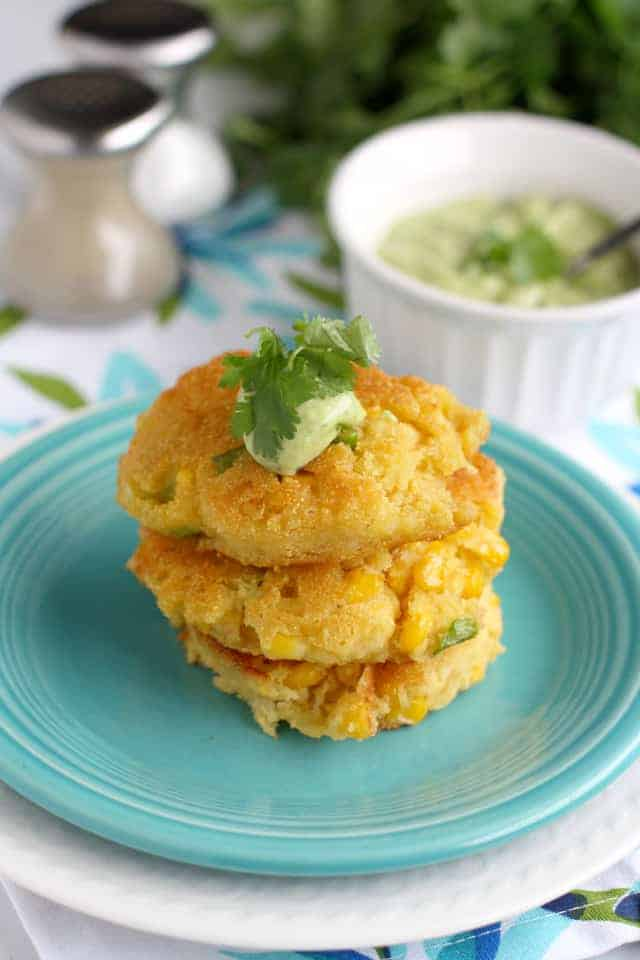 Delicious fried corn cakes with cilantro avocado cream.