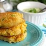 Fried corn cakes with a creamy avocado cilantro dressing. Vegan.