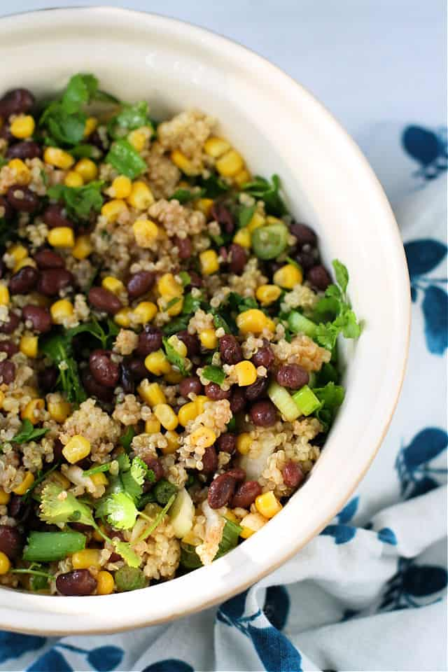 quinoa salad with beans and corn in a white bowl