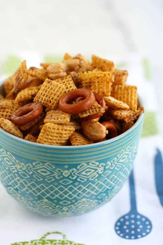 dairy free chex mix in a blue bowl in a dish towel