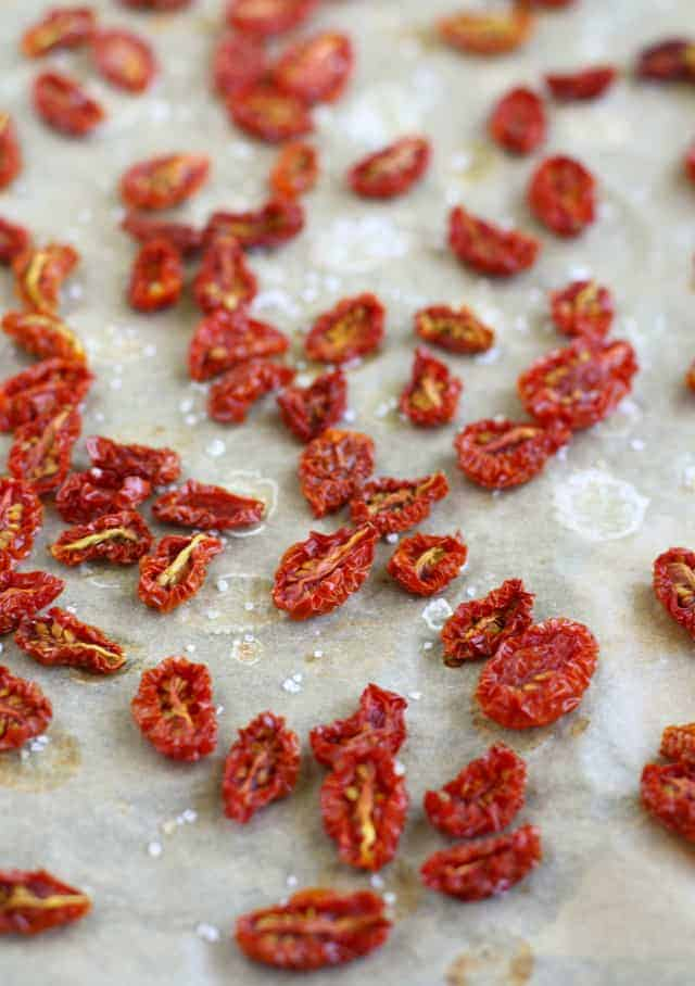 oven dried tomatoes on a baking sheet
