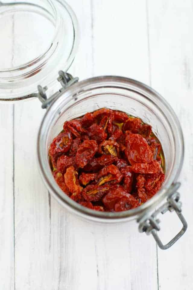 sun dried tomatoes in a jar with oil