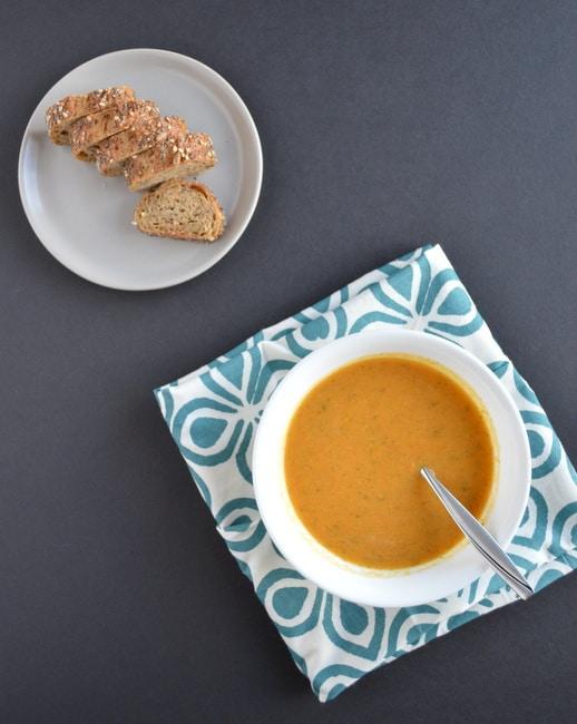 Carrot Sweet Potato soup in a white bowl