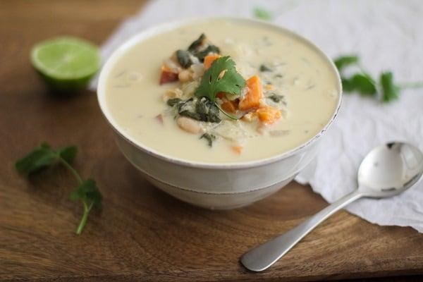 Sweet potato quinoa stew in a white soup bowl