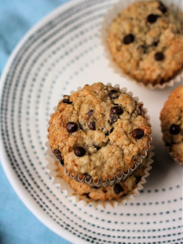 chocolate chip banana oat muffins on a white plate
