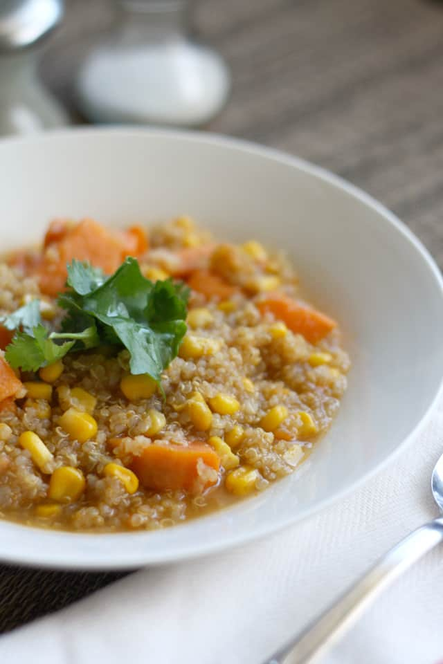 Corn, quinoa, and sweet potato chowder in a shallow white bowl