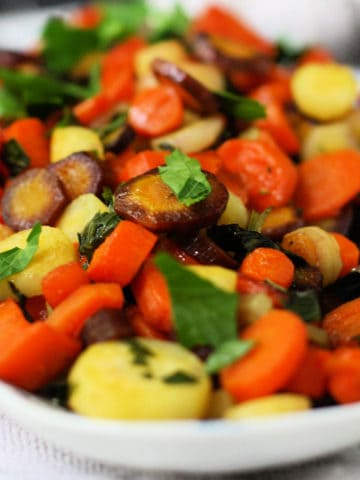 roasted rainbow carrots in a white dish