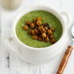 A creamy and healthy broccoli potato soup topped with Indian spiced chickpeas.