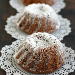 Spicy and moist gingerbread mini bundt cakes with a dusting of powdered sugar make a festive holiday dessert!