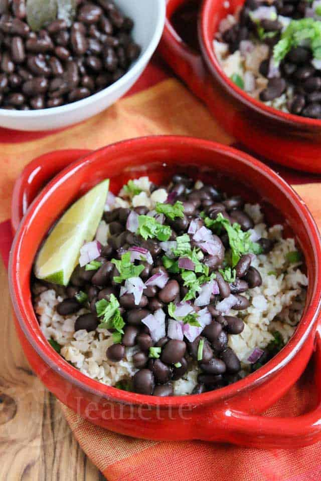 Slow Cooker Chipotle Black Beans in red soup bowls