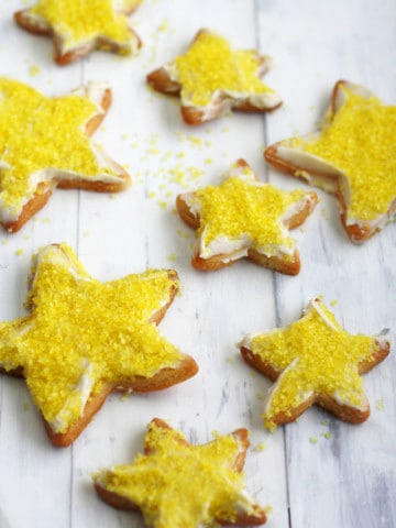 Festive and delicious vegan lemon frosted sugar cookie recipe.