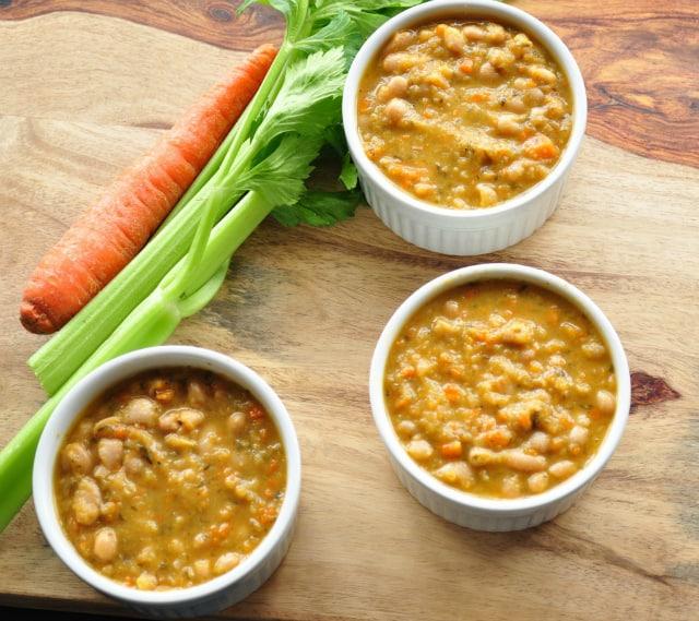 white bean soup in white bowls