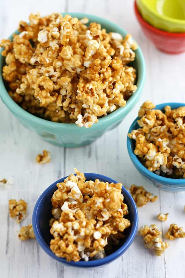 dairy free vegan caramel corn in colorful bowls