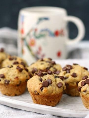vegan banana chocolate chip mini muffins on a white plate