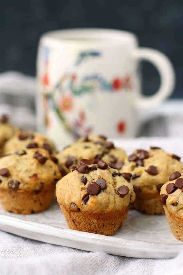 vegan banana chocolate chip mini muffins on a white plate