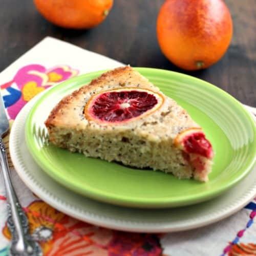 blood orange poppy seed cake on a light green plate