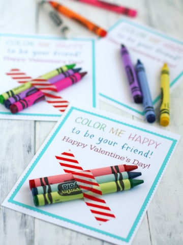 Printable Color Me Happy Valentine cards on theprettybee.com. Make these cute printables for your kids to pass out! So easy! Just tape a few crayons on to each one with colorful washi tape. #valentinesday