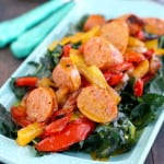 Kale salad with sausages, peppers, and a honey mustard dressing. Delicious and healthy!