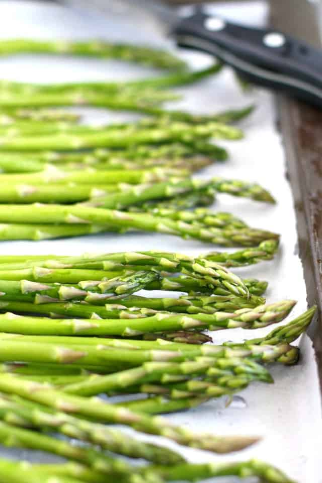 asparagus on a baking sheet